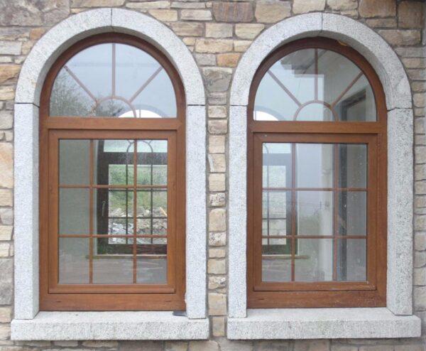 Дизайн арочного окна в стене